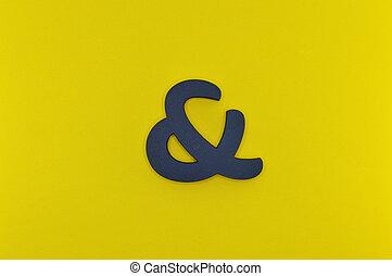 black bold ampersand on yellow background