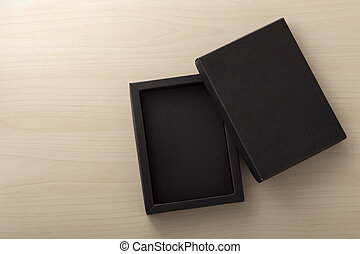 Black box packaging on wooden background