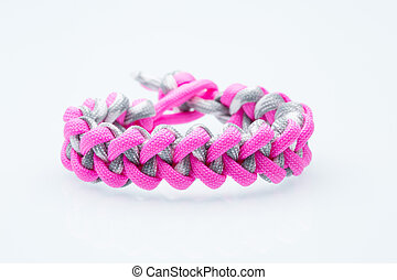 Black braided bracelet on white background.  synthetic cord