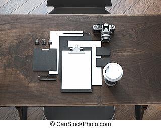 Black branding mockup on the wooden table. 3d rendering