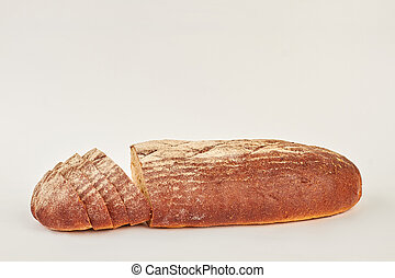 Black bread on white background.