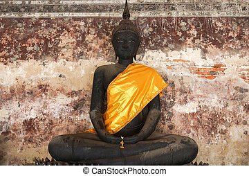 Black buddha ancient  in temple, Thailand.