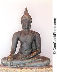 black buddha image in sitting posture