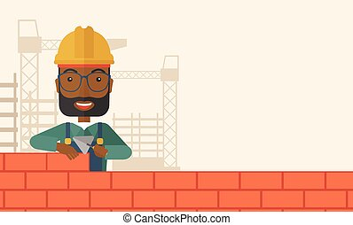 Black Builder Man Is Building A Brick Wall