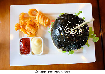 Black burger with meat pork