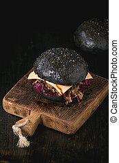 Black burger with stews