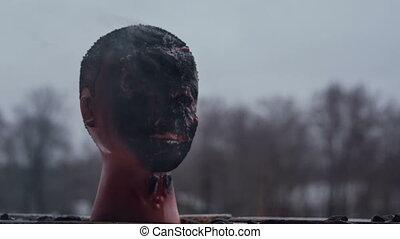 Black burned mannequin head close up. - Black burned...