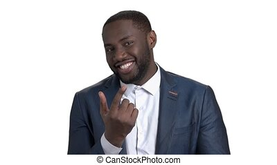 Black business man showing come here gesture with index finger.