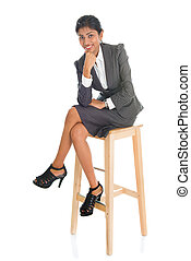 Black business people seated on chair.