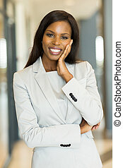 black business woman looking at the camera