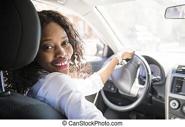 Black Business woman on a white car