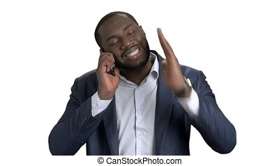Black businessman arguing with someone on phone.