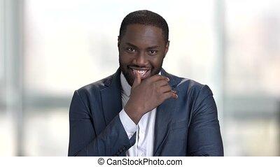 Black businessman flirting in office. Happy afro american...