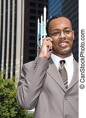 Black businessman on cell phone