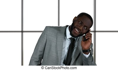 Black businessman on the phone.