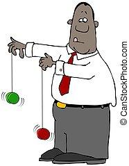 Black businessman playing with two yo-yos