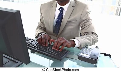 Black businessman raising his arms