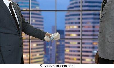 Black businessman refuses money. Bribery on evening city...