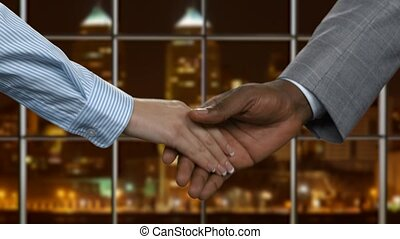 Black businessman shaking female hand.