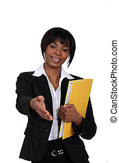 black businesswoman holding filer