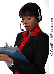 black businesswoman looking stunned with headset
