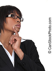 black businesswoman looking upwards