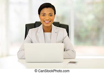 black businesswoman relaxing in office