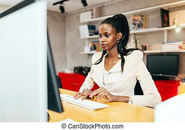 Black businesswoman using computer