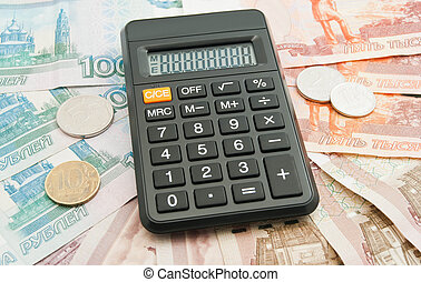 calculator, different Russian banknotes and coins