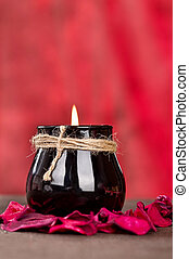 Black candle cup on red background