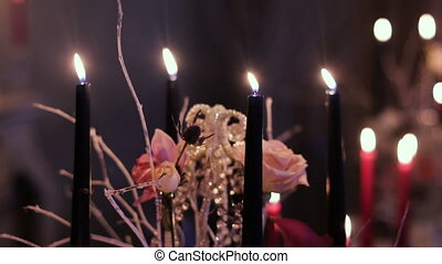 black candles on the dinner table