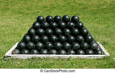 black cannonballs - a canonball stack of 18 pound black...