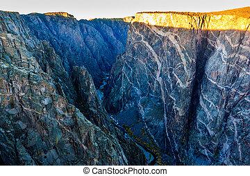 Black canyon glowing gold