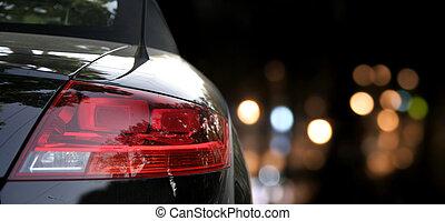 Black car in traffic at night