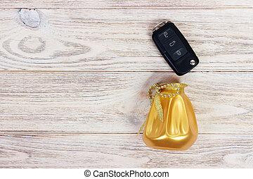 Black car key in a present box. Top view, copy space