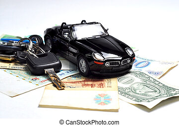 Black car, keys and money isolated