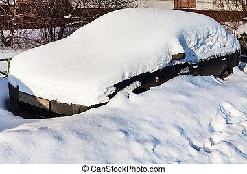 black car under fresh snow in parking lot
