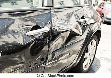 Black car with dent - Closeup of modern black car with dents