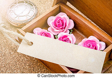 Black card and pink rose.