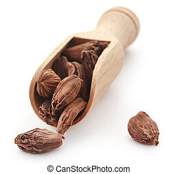 Black cardamom in wooden scoop