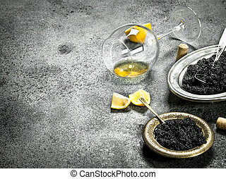 Black caviar with a glass of white wine.