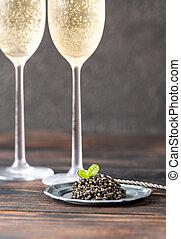 Black caviar with champagne