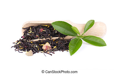 Black ceylon tea with rose petals, cornflowers and sunflower, isolated on white background.