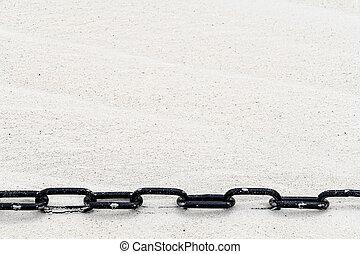 black chain in sand