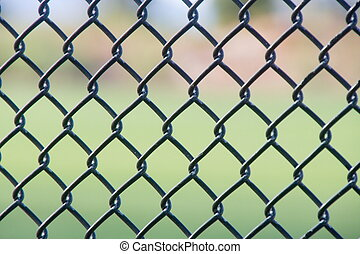 Black Chain Link Fence - A black chain link fence with an...