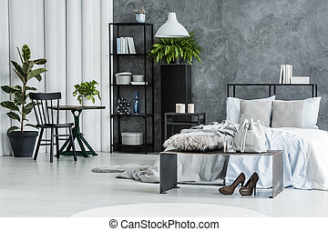 Black chair in bright bedroom
