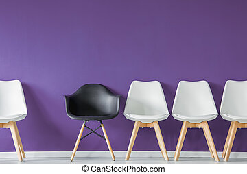 Black chair in row