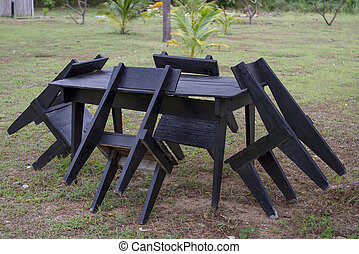 Black chair table set in the garden.