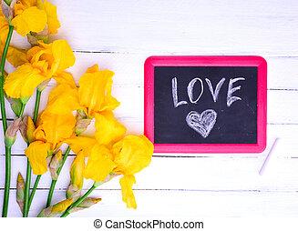 Black chalk board with the inscription love