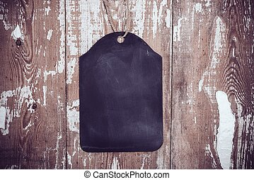 Black chalkboard on old wooden board background